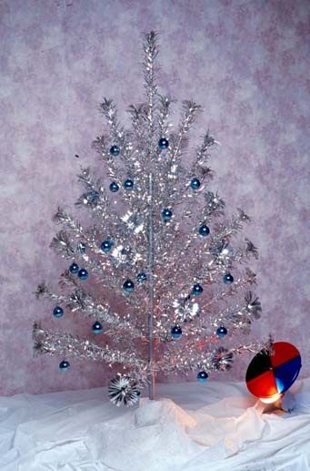 does anyone make those metal silver christmas trees anymore invented in 1959 the shimmering silver christmas trees started showing up in homes in the 60s - Silver Tinsel Christmas Tree